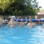 Thue the guys in the pool Mike, Clyde, Howard, Richard and   John  showing their muscles